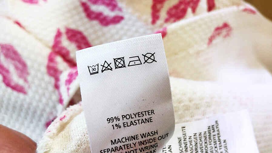 Waschetikette mit Waschsymbolen